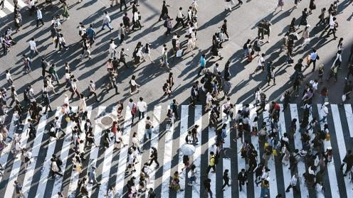 Aerial view of people walking down the street