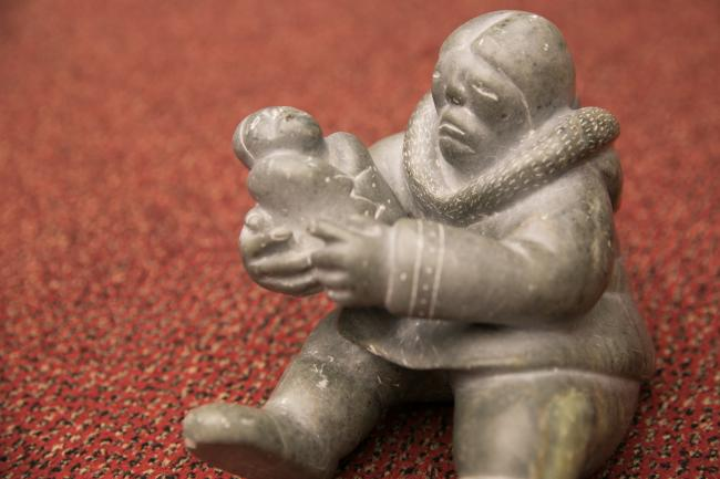 This Inuit carving of a mother and child, a gift of the Inuit Circumpolar Council to UNEP in 1999, is often displayed at Stockholm Convention meetings to remind participants of the significance of their work to protect human health and the environment. (photo from 2017 Conference of the Parties)